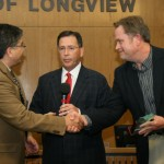 Corey Howell (right), Human Resource Director of R&K Distributors accepts an appreciation award from the City of Longview Transit General Manager Rob Stephens while  Mayor Jay Dean (middle) looks on.