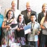 Forty students received trophies and were displayed at Tyler Bank and Trust, West Grande; Suddenlink Corporate Offices, ESE Loop 323; and the Tyler Museum of Art. Front row: Best in Show Recipients: Jose Basilio, Avery Allison, Ana Ruiz and Elizabeth Ortiz. Back row: Barbara Bass, Mayor of Tyler; Todd Cruthird, Suddenlink VP and creator of the event; Larry Goddard, Executive Director, Tyler ISD Foundation; and Dr. Kimberly Russell, Tyler Junior College Vice President Advancement.