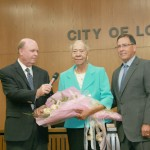City Council Woman District 3 Sydney Willis says her goodbye to the Council as City manager David Willard and Mayor Jay Dean look on.