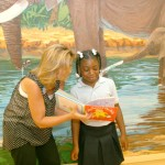 Dr. Kristi Bagnell reads to Morgan Coyle during a routine visit to Premier Pediatrics