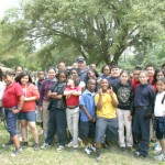 Ms. Pegues' 5th grade class takes a photo with Police Officer Harrod on Career Day