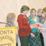 LIHN Director Doris Ramaly receives a grant from ZONTA while other grantees look on.